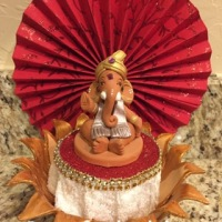 Paper fan backdrop for Ganesha..